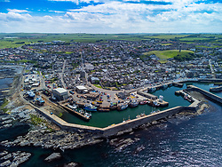 Aerial view from drone of harbour and shipyards at Macduff on Moray Firth coast in Aberdeenshire, Scotland, UK