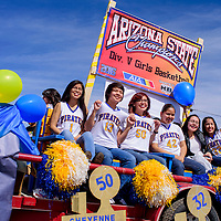 Players on the Valley Sanders High School state champion basketball team show their pride on a parade float in Sanders Friday.