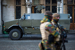 "© Licensed to London News Pictures. 23/11/2015. Brussels, Belgium. A Belgian military vehicle parked The Grand Place, the main square in central Brussels where the city is currently on ""lockdown"" amid ""imminent threat"" of Paris-style bomb and gun attacks. Photo credit: Ben Cawthra/LNP"