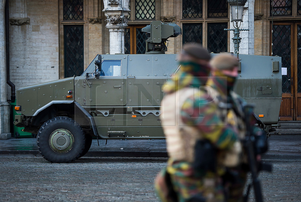 """© Licensed to London News Pictures. 23/11/2015. Brussels, Belgium. A Belgian military vehicle parked The Grand Place, the main square in central Brussels where the city is currently on """"lockdown"""" amid """"imminent threat"""" of Paris-style bomb and gun attacks. Photo credit: Ben Cawthra/LNP"""