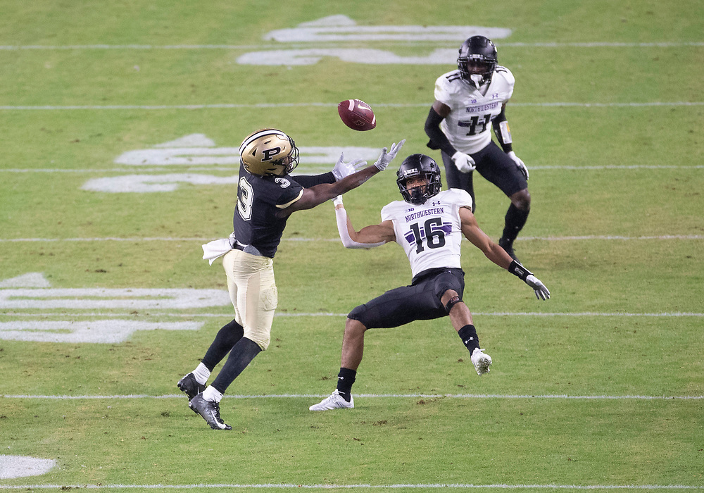 November 14, 2020:  Purdue wide receiver David Bell (3) attempts to catch the ball as Northwestern defensive back Brandon Joseph (16) defends during NCAA football game action between the Northwestern Wildcats and the Purdue Boilermakers at Ross-Ade Stadium in West Lafayette, Indiana. Northwestern defeated Purdue 27-20.  John Mersits/CSM.