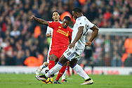 Victor Anichebe of Sunderland (r) tackles Georginio Wijnaldum of Liverpool. Premier League match, Liverpool v Sunderland at the Anfield stadium in Liverpool, Merseyside on Saturday 26th November 2016.<br /> pic by Chris Stading, Andrew Orchard sports photography.