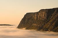 Dawn mist washing at foot of Tjahkkelij, Sarek National Park, Laponia World Heritage Site, Sweden
