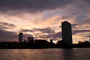 Sunset view of a tower block in Rotherhithe from the River Thames in London, England, United Kingdom. Taken from a riverboat offering a unique view.