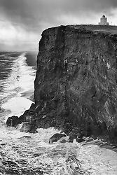 The lighthouse at Dyrholaey, south coast of Iceland in windstorm