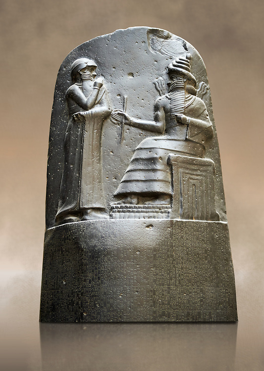Babylonian Hammurabi stone relief sculpture. Hammurabi was the sixth Amorite king of Babylon from 1792 BC to 1750 BC . Hammurabi (standing), depicted as receiving his royal insignia from Shamash. Hammurabi holds his hands over his mouth as a sign of prayer. The Vorderasiatisches Museum, part of the Pergamon Museum, Berlin .<br /> <br /> If you prefer to buy from our ALAMY PHOTO LIBRARY  Collection visit : https://www.alamy.com/portfolio/paul-williams-funkystock/babylon-antiquities.html<br /> <br /> Visit our ANCIENT WORLD PHOTO COLLECTIONS for more photos to download or buy as wall art prints https://funkystock.photoshelter.com/gallery-collection/Ancient-World-Art-Antiquities-Historic-Sites-Pictures-Images-of/C00006u26yqSkDOM