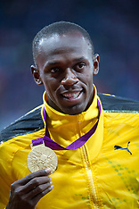 Usain Bolt with his 100m Gold medal 6-8-12