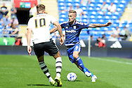 Cardiff's Joe Ralls  (r) takes on Fulham's Thomas Cairney (10). Skybet football league championship match, Cardiff city v Fulham at the Cardiff city stadium in Cardiff, South Wales on Saturday 8th August  2015.<br /> pic by Carl Robertson, Andrew Orchard sports photography.