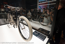 Checking out the prized 1903 Harley-Davidson motorcycle on display during a tour of the Harley-Davidson Museum during the Milwaukee Rally. Milwaukee, WI, USA. Saturday, September 3, 2016. Photography ©2016 Michael Lichter.