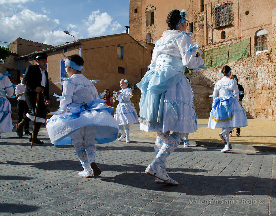 Kids dancing at the begining of the procession on the Eve of St. Juan Lorenzo festivities in Cetina, Zaragoza.