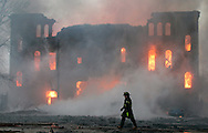 A firefighter walks by as the Pilgrim Baptist Church goes up in flames in Chicago, Friday, Jan. 6, 2005. The church, a Chicago landmark since 1981, was designed by the famous architectural firm of Adler & Sullivan and built between 1890 and 1891. (AP)