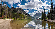 """Slide Lake in Bridger-Teton National Forest, Wind River Range, Rocky Mountains, Wyoming, USA. Hike from Green River Lakes to Slide Lake (13+ miles round trip with 2100 feet gain). The Continental Divide follows the crest of the """"Winds"""". Mostly composed of granite batholiths formed deep within the earth over 1 billion years ago, the Wind River Range is one of the oldest mountain ranges in North America. These granite monoliths were uplifted, exposed by erosion, then carved by glaciers 500,000 years ago to form cirques and U-shaped valleys. Glaciers scoured the terminal moraine which naturally dams the Green River Lakes, the headwaters of the Green River (chief tributary to the Colorado River). This image was stitched from multiple overlapping photos."""