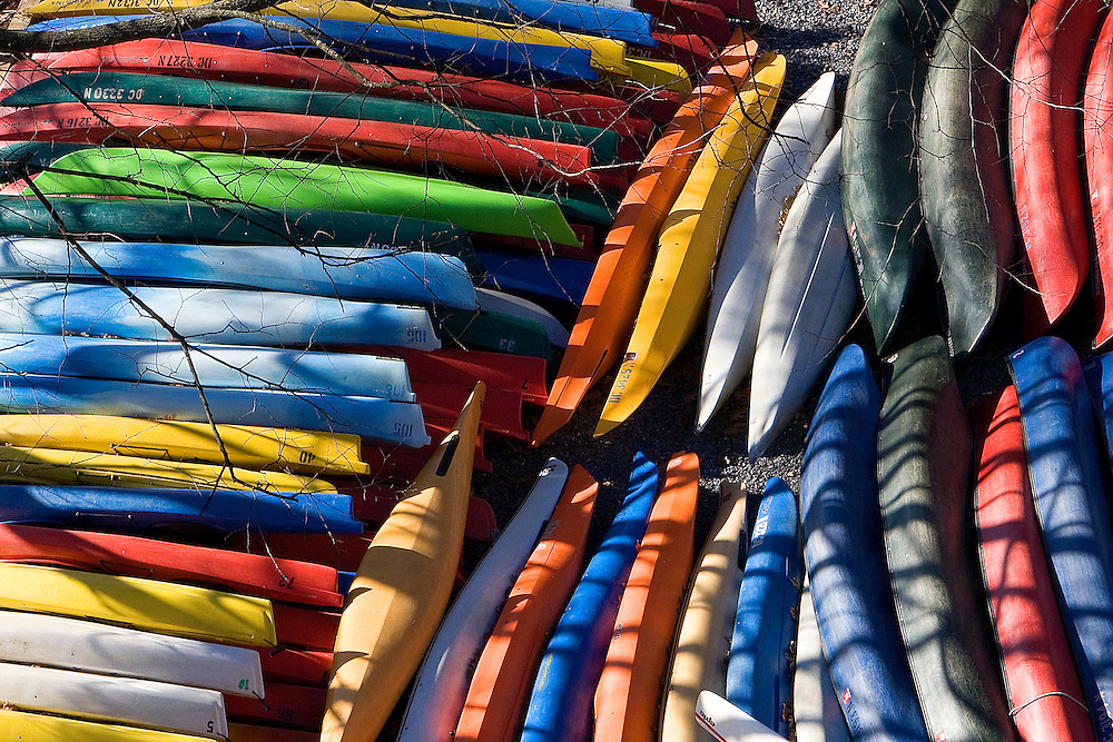 Winter canoe colors stacked up in Georgetown along the Potomac River during the off season in Washington, DC