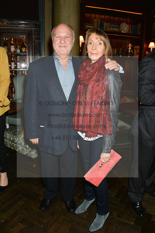HARVEY GOLDSMITH and his wife DIANA at the Installation And Reveal Of Gerald Scarfe's Exclusive Artworks In Scarfes Bar at Rosewood Hotel, 252 High Holborn, London on 7th April 2014.