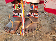 Detail of Maasai tribeswomans feet with traditional bead decoration, Tipilit village near Amboseli National Park, Kenya