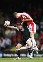 Photo: Rich Eaton.<br /> <br /> Bristol City v Swansea City. Coca Cola League 1. 07/04/2007. Jamie McCombe right of Bristol rises above Swanseas Lee Trundle