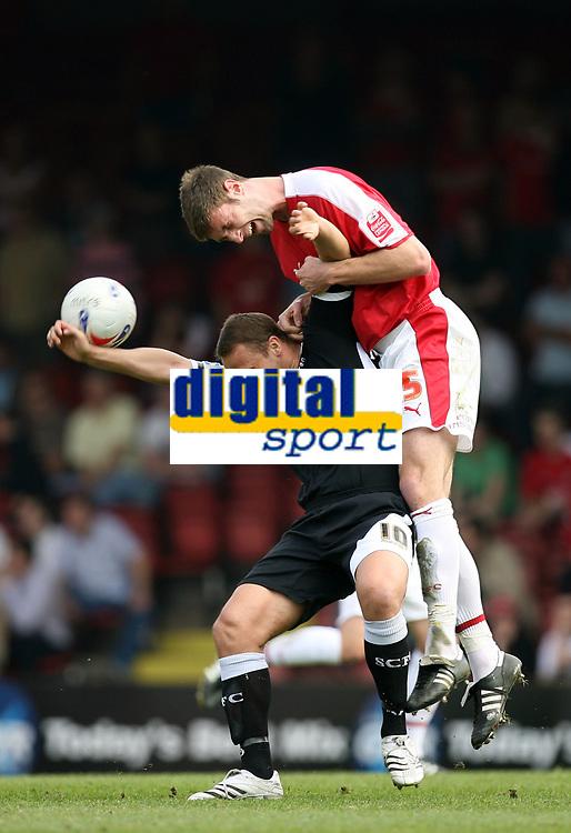 Photo: Rich Eaton.<br /> <br /> Bristol City v Swansea City. Coca Cola League 1. 07/04/2007. Jamie McCombe right of Bristol rises above Swanseas Lee Trundle