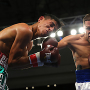 KISSIMMEE, FL - MARCH 06:  Jonathan Oquendo (R) lands a punch to the face of Gabino Cota as they fight for the WBO Latino Flyweight Title during the Telemundo Boxeo boxing match at the Kissimmee Civic Center on March 6, 2015 in Kissimmee, Florida. Oquendo won the belt after a 10 round unanimous decision on the scorecards. (Photo by Alex Menendez/Getty Images) *** Local Caption *** Jonathan Oquendo; Gabino Cota