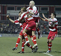 Photo: Aidan Ellis.<br /> Doncaster Rovers v Aston Villa. Carling Cup. 29/11/2005.<br /> Doncaster's Paul Hefernan ismobbed after he scored the second goal