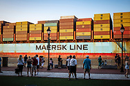 Savannah, Georgia, USA - July 25, 2021: People watch the arrival of a Maersk Line ship, the MSC Ellen, as it moves up the Savannah River toward its docking point.