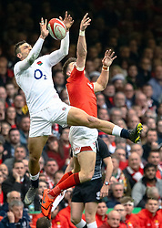 Jonny May of England and Josh Adams of Wales got for the high ball<br /> <br /> Photographer Simon King/Replay Images<br /> <br /> Six Nations Round 3 - Wales v England - Saturday 23rd February 2019 - Principality Stadium - Cardiff<br /> <br /> World Copyright © Replay Images . All rights reserved. info@replayimages.co.uk - http://replayimages.co.uk