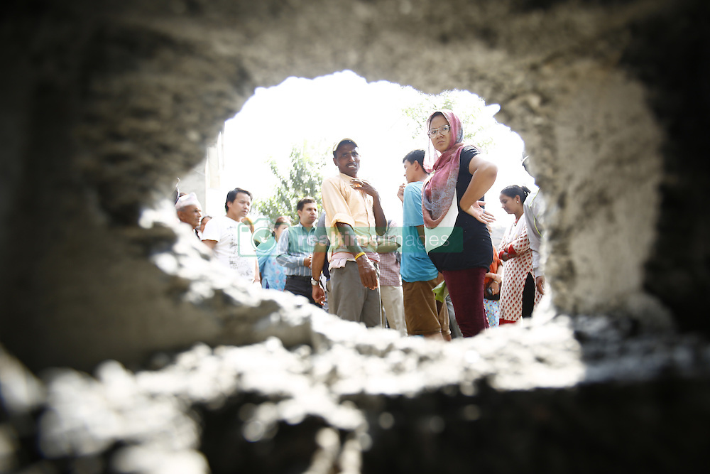 September 20, 2016 - Kathmandu, Nepal - Nepalese people look at a hole after a pressure cooker bomb exploded the wall at Akashdeep School in Jorpati, Kathmandu, Nepal on Tuesday, September 20, 2016. Improvised explosive devices were placed in 7 schools as 2 bombs exploded. No human casualties have been reported in the explosions. (Credit Image: © Skanda Gautam via ZUMA Wire)