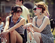Vintage looking photo of 2 stylish girls with sunglasses. NYC 2010