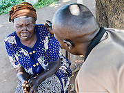 One to One Counselling.  This woman becomes upset during her session as she discusses her memories with one of the consellors trained by the charity. Visit to the work of Network for Africa in Patongo, Northern Uganda, November 2012.