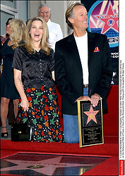 File photo - © Lionel Hahn/ABACA. 51582-7. Los Angeles-CA-USA, October 22 2003. Peter Fonda is honored with the 2,241st star on the Hollywood Walk of Fame in front of the Roosevelt Hotel. Posing with his daughter Bridget Fonda. Peter Fonda, the star, co-writer and producer of the 1969 cult classic Easy Rider, has died at the age of 79. Peter Fonda was part of a veteran Hollywood family. As well as being the brother of Jane Fonda, he was also the son of actor Henry Fonda, and father to Bridget, also an actor.