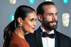 Maria Dolores Dieguez and Joseph Fiennes attending 72nd British Academy Film Awards, Arrivals, Royal Albert Hall, London. 10th February 2019