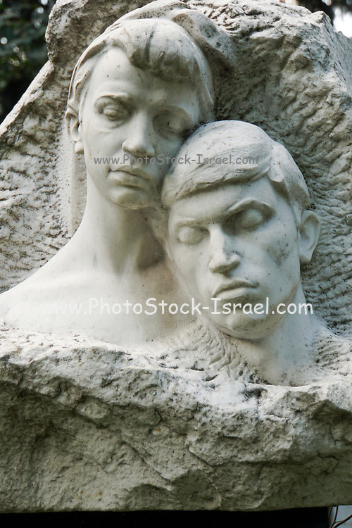Grieving young couple statue Novodevichy Cemetery, Moscow, Russia