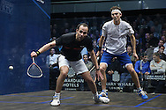 Mohaired Reda of Egypt (in the black shirt) playing a shot against Cameron Piley of Australia (in the white shirt). Canary Wharf Squash Classic 2016 , day two at the East Wintergarden in Canary Wharf , London on Tuesday 8th March 2016.<br /> pic by John Patrick Fletcher, Andrew Orchard sports photography.