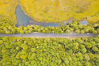 Aerial view of road crossing next to Mirror Lakes, observation deck, New Zealand.