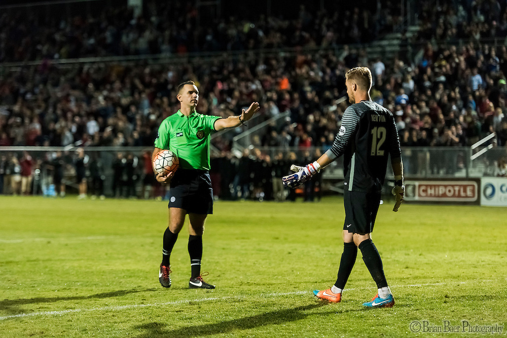 The referee talks to Sac Republic FC goalie Evan Newton (12), during penalty kicks of the USL Western Conference first round playoff game between the Republic FC and the visiting Orange County Blues FC at Bonney Field, Saturday Oct 1, 2016. The Orange County Blues FC won 5-4 after penalty kicks<br /> photo by Brian Baer