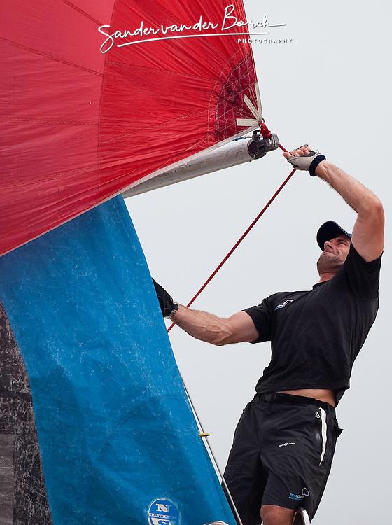Iain Percy on the bow. Monsoon Cup 2009. Kuala Terengganu, Malaysia. 3 December 2009. Photo: Sander van der Borch / Subzero Images