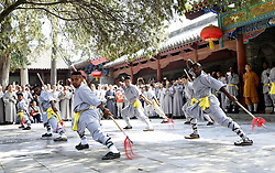 DENGFENG, Sept. 24, 2016 (Xinhua) -- African apprentices perform Kungfu at the Shaolin Temple on the Songshan Mountain in Dengfeng City, central China's Henan Province, Sept. 23, 2016. A total of twenty apprentices from Africa graduated here on Friday after three-month training programs on Kungfu and Shaolin culture. (Xinhua/Feng Dapeng)(wyo) (Credit Image: © Feng Dapeng/Xinhua via ZUMA Wire)