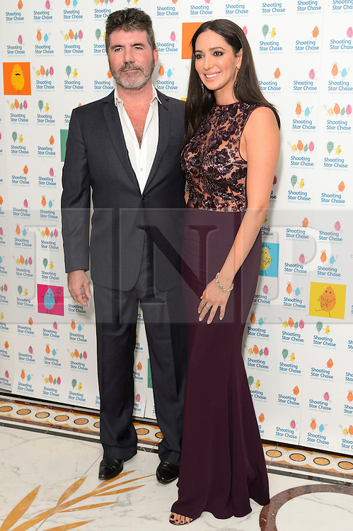 © Licensed to London News Pictures. 01/10/2016. SIMON COWELL and LAUREN SILVERMAN attend the annual Shooting Stars CHASE fundraising ball.  London, UK. Photo credit: Ray Tang/LNP