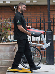 © Licensed to London News Pictures. 30/07/2018. London, UK.  Removal men taking a weights bench into a van outside the Foreign Secretary's official residence at Carlton Gardens in central London where the former Foreign Secretary, Boris Johnson is moving out following his resignation.  Photo credit: Vickie Flores/LNP