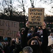 Hundreds of people gathered at a peaceful vigil for Sarah Everard on Clapham Common in South London on the 13th of March 2021, London, United Kingdom. Sarah Everard went missing on 3 March after setting off at 9pm from a friend's house to make her two-and-a-half-mile journey home and was days later found murdered. People had turned out to pay respect and love and mourn Sarah Everard as well as all the women and girls who on a daily basis are hurt by men. It was an event full of sadness and reflection and anger but peaceful. The vigil was not sanctioned by police because of Covid restrictions and the police decided to arrest a number of people in an attempt to break up the peaceful and highly emotional vigil. The event took place around the band stand on the common and speeches were held from the stand till police confiscated the sound equipment. The police have since been highly criticized for their handling of the event.