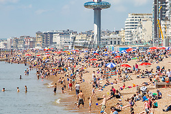 © Licensed to London News Pictures. 28/05/2018. Brighton, UK. Members of the public take advantage of the hot and sunny weather to spend time on the beach in Brighton and Hove on the last day of the Bank Holiday Weekend. Today, Monday May 28th 2018 is predicted to be the hottest day of the year so far. Photo credit: Hugo Michiels/LNP
