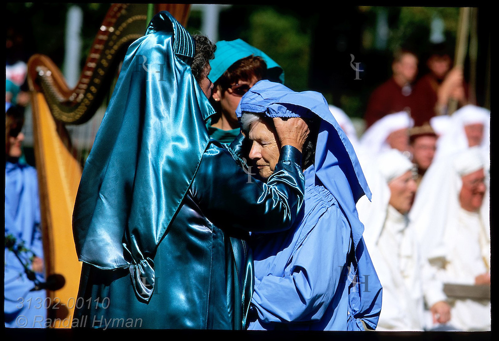 Green-robed mistress of costumes crowns member of Gorsedd of Bards at Natl Eisteddfod coronation; Welshpool, Wales