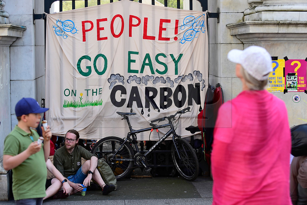 """© Licensed to London News Pictures. 22/04/2019. LONDON, UK.  A sign made by activists gathered at Marble Arch during """"London: International Rebellion"""", on day eight of a protest organised by Extinction Rebellion.  Protesters are demanding that governments take action against climate change.  After police issued section 14 orders at the other protest sites of Oxford Circus, Waterloo Bridge and Parliament Square resulting in over 900 arrests, protesters have convened at the designated site of Marble Arch so that the protest can continue.  Photo credit: Stephen Chung/LNP"""