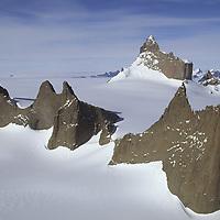 ANTARCTICA, Queen Maud Land.  Fenris Mountains. 2931m Ulvetanna bkg. Midgard on right.
