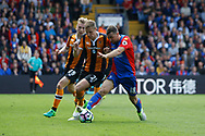 Hull City Defender Michael Dawson gets a tackle in against Crystal Palace midfielder James McArthur during the Premier League match between Crystal Palace and Hull City at Selhurst Park, London, England on 14 May 2017. Photo by Andy Walter.