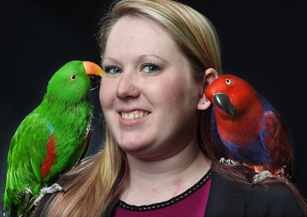 Photo by Mara Lavitt -- Special to the Hartford Courant<br /> March 21, 2015, Middletown<br /> The eighth FeatherFest was held in Middletown by the Connecticut Parrot Society providing visitors with education about parrots and other birds. Caitlin Keane of Manchester with her eclectus parrot Simon, left, and Ava at right who belongs to Peter Lombardo of Rocky Hill. Ecelctus males are green, females are red. Keane fosters for the CT Parrot Society and has placed 14 parrots. Keane adopted Simon who came to her a year and a half ago when his owner died.