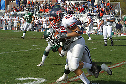 22 October 2005: Thunder ball carrier Kirk Sundberg gets wrapped up by a Titan defender. The Illinois Wesleyan Titans posted a 23 - 14 home win by squeeking past the Thunder of Wheaton College at Wilder Field (the 5th oldest collegiate field in the US) on the campus of Illinois Wesleyan University in Bloomington IL