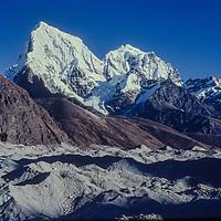 Cholatse and Taboche Peak rise behind the Ngozumpa Glacier in the Khumbu region of Nepal's Himalaya.