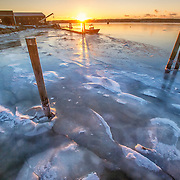 Sunrise on the frozen St. George River. Thomaston, Maine