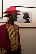ABDEL TAVARES WITH THE PORTRAIT OF HIM BY DAVID CANTOR, Private view of the Taylor Wessing Portrait prize, National Portrait Gallery, London.  15 November 2016