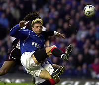 Rangers v  Motherwell, Scottish Premier Division.<br />Ibrox Park.       Pic Ian Stewart, December 10th. 2000.<br /><br />Tore Andre Flo shoots over thebar as he gets the better of Benito Kemble
